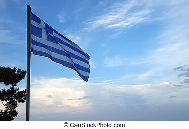 The Greek National Flag waving over blue sky
