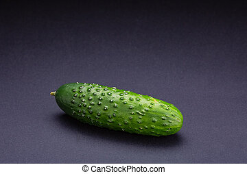 The green cucumber on the black background