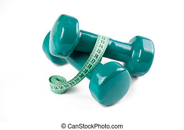 green dumbell with measuring tape - the green dumbell with...