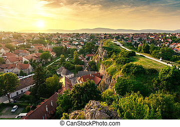 The green hill garden in the middle of old town Veszprem, Hungary at sunset
