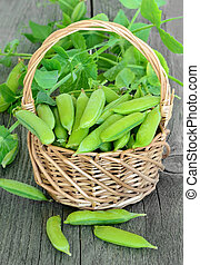 The green peas on wooden table