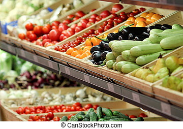 The grocery store sells various vegetables, tomatoes, cucumbers, eggplants, peppers, zucchini.