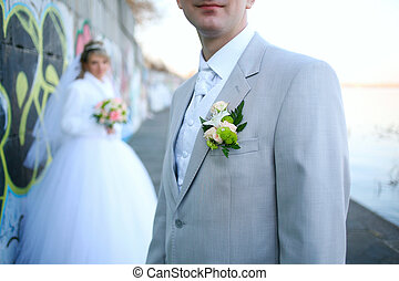 Boutonniere for jacket - The groom at a wedding ceremony. ...