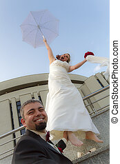 The groom can not escape the bride with umbrella