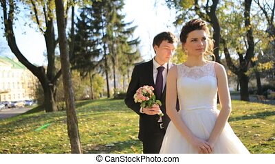 The groom comes to his beautiful bride, they laugh and rejoice shot in slow motion  close up