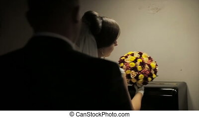 the groom comes to the bride in a dark room