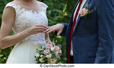 The groom places the ring on the bride's hand. - Wedding...