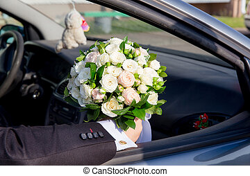 The groom sitting in car