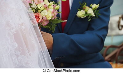 The groom takes the bride by the hands