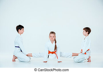 The group of boys and girl at Aikido training in martial arts school. Healthy lifestyle and sports concept