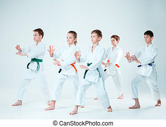 The group of boys and girl fighting at Aikido training in martial arts school. Healthy lifestyle and sports concept