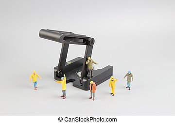Group of construction workers repairing tool
