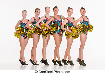 The group of teen cheerleaders posing at white studio - The...