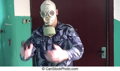 The guard, dressed in military uniform in the mask does not pass the man with the camera.