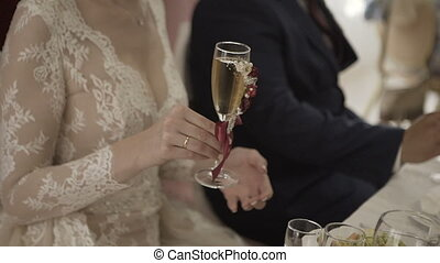 The guests' hands take glasses with bubbling wine at the party. Glasses are built in the pyramids. No recognizable persons