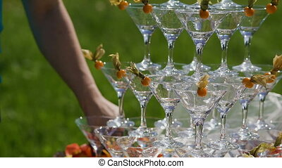 The guests' hands take glasses with bubbling wine at the...