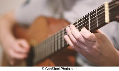The guitarist plays an acoustic guitar. Guitarist hand and...