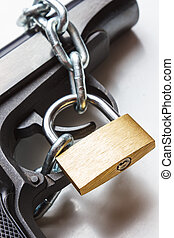the gun, chain and closed padlock