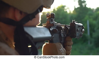 The gun for airsoft closeup. Slow motion