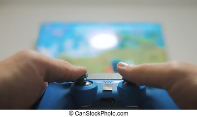 The guy boy is playing on controller joystick gamepad the...
