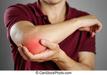 The guy has a sore elbow. The pain in my arm. Closeup. The...