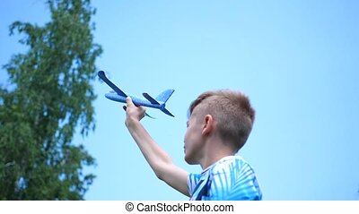 the guy holds in arm aircraft plain, simulates flight - the...