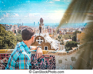 The guy in Barcelona Park Guell. Travel to Spain. View of the city.