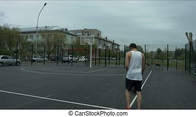 The guy is on the basketball court with the ball