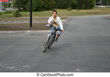 The guy on a bicycle