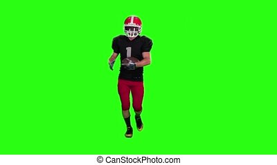 The guy runs in a protective helmet. Slow motion. Green screen