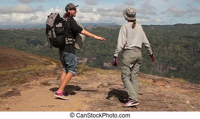 The guy takes the girl by the hand and they leave. Mountain...