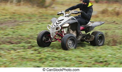 the guy with the mask on face riding ATV