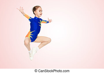 The gymnast performs a jump.
