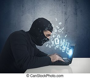 The hacker - Hacker at work with a laptop and binary number