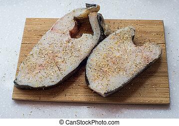 the halibut steak on a chopping Board - Halibut fish steak ...