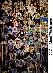 The hamsa and magen David, Arab market in Old City of...