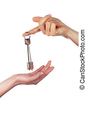 The hand holds a key from the house