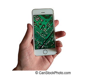 The hand of a white-skinned man holds a smartphone with the printed circuit board on the screen. Isolated on a white background.