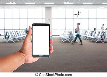 the hand of man hold mobile phone over people are waiting for the airpalne