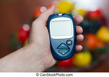 the hand of the elderly woman keeps the device for measurement o