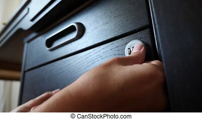 The hand opens the coded lock of the safe. 4k. Slow motion....