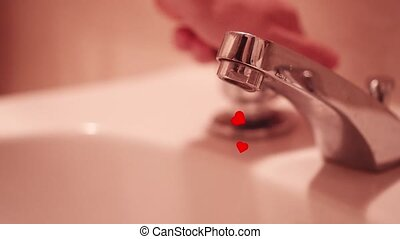 The hand opens the tap from which come out many red hearts
