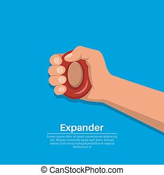 The hand squeezes a rubber carpal expander.Concept of a...