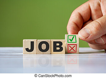 The hand turn wooden block with red reject X and green confirm tick as change concept of JOB. Word JOB conceptual symbol