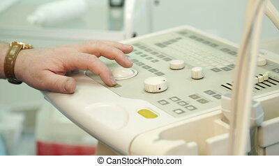 The hand with the clock on the wrist controls the ultrasound...