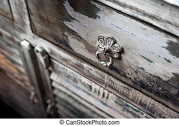 the handle of an old rustic cupboard, a drawer
