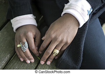 the hands of a black man with rings
