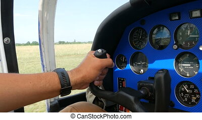 The hands of a professional pilot hold the helm and control ...