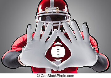 The hands of american football player on white