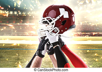 The hands of american football players with helmet on white background